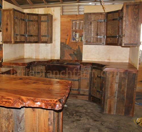 Barn wood kitchen cabinets with hand forged hinges and natural wood